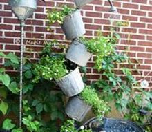 marie s tipsy solar fountain, container gardening, crafts, gardening, ponds water features, repurposing upcycling, Marie Niemann tells how she did this project mostly by herself She says I finally finished it Inspired by my good friend and Flea Market Gardening contributor and artist Annie Steen with her tipsy galvanized water feature
