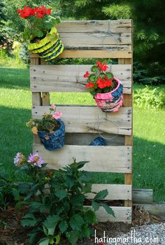 fun and bright brick patio, outdoor furniture, outdoor living, patio, 1 2 a pallet some wire and s hooks makes for a fun planter holder