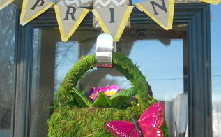 spring door decor, doors, home decor, seasonal holiday decor, I found this little moss bag at the local garden center I planted it with a purple primrose then added the butterfly and hung it on the door to welcome spring I can t leave it out just yet but on warm days I will