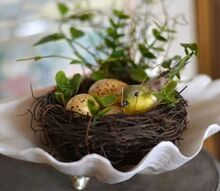 spring time accessories, seasonal holiday d cor, A small nest found a home in a seashell in this vignette
