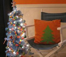 bright amp cheerful kid s christmas decor, christmas decorations, crafts, seasonal holiday decor, The pillow is plain orange fleece To spruce it up for Christmas I cut a tree shape from felt stuck it on the pillow The felt clings to the fleece