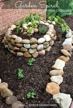 how to create a small vegetable garden using a garden spiral, gardening, Last year I stumbled upon a photo of a herb garden spiral and thought that this technique was perfect for my small vegetable garden