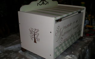 toy box, painted furniture, stenciled a tree on both sides And a resin scroll work on the top