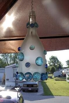 wine bottle lamps, crafts, repurposing upcycling, Wine bottle lamp hung under umbrella on deck