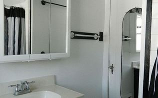 bathroom makeover, bathroom ideas, home decor, small bathroom ideas, After I painted the vanity black and the cabinets white The stripes ended at the top of the door