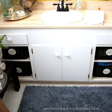 bathroom makeover stripes amp inexpensive organization ideas, bathroom ideas, doors, home decor, organizing, Removing the cabinet doors and adding baskets gave the space more personality and gives it more of a custom look