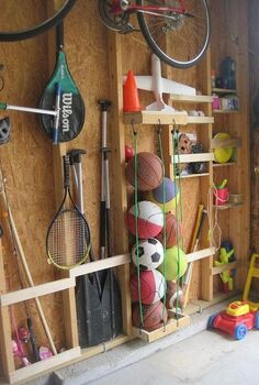 garage storage, cleaning tips, doors, garages, shelving ideas, storage ideas, Nailing slats to the studs provided space to store oars fishing poles baseball bats For balls we nailed a U shape top bottom drilled holes attached bungee cords into the holes