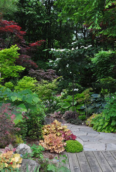 another example of a beautiful shade garden, flowers, gardening, outdoor living, Throughout the garden and especially along its outer perimeter mature trees cast pockets of Garden Canadensis into shade and part shade