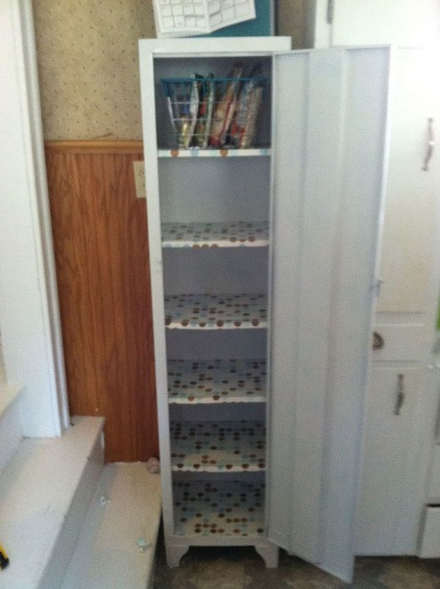 old metal cabinet turned into pantry, painted furniture, Shelves are lined  with polka dot - Old Metal Cabinet Turned Into Pantry Hometalk