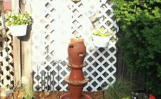 terracotta fountain, gardening, ponds water features, I found this idea on HomeTalk and tried it out I had all the materials but had to but a bigger pump and larger tubing but I think it turned out nice