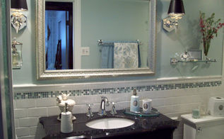 spa blue bathroom makeover on a budget, bathroom ideas, home improvement, tiling, Here is the mirror from a resale shop and I love it Perfect size color and price Continue the white subway tile from the bathtub onto the wall behind the vanity and a small line of glass accent tile