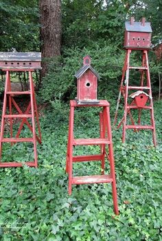 repurpose ladders into birdhouse stands, gardening, repurposing upcycling, Mount birdhouses on old ladders to create functional garden accents I painted the ladders and the birdhouses in the same barn red to make them a grouping They bring color to a shady area covered in ivy Best of all they are occupied