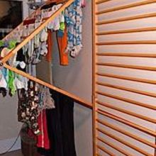 diy wall mounted clothes drying rack, repurposing upcycling, urban living, The rack hinges to fold out in the center but lay flat when not in use