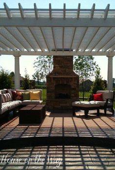 creating a gorgeous outdoor space, decks, outdoor living, Pergola and outdoor chimney with outdoor sectional and all weather wicker coffee tables