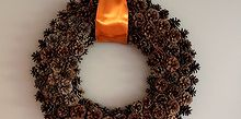 free pinecone wreath, crafts, seasonal holiday decor, wreaths, Adding a large satin ribbon seems to pull everything together