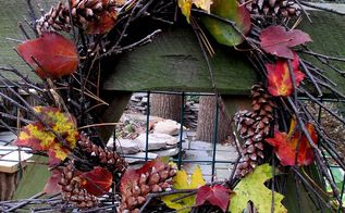 twig wreath decorated for fall, crafts, outdoor living, seasonal holiday decor, wreaths, Tucked a few Fall leaves and pine cones into the back gate twig wreath this morning We are outside today getting things ready for our uninvited house guest Sandy http pinterest com barbrosen