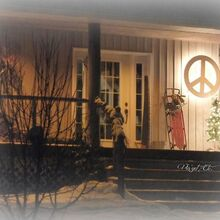 christmas was simple and calm for us this year, christmas decorations, seasonal holiday decor, Our simple front porch that peace sign glowed all over the property