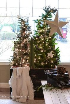 a christmas tree forest in a crate, seasonal holiday d cor, Slightly bending the tops to the sides added an unexpected whimsical take A star theme came into play with music sheet stars and one big guy just for fun