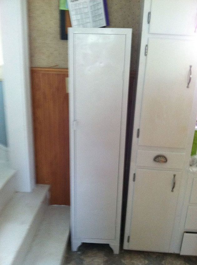 old metal cabinet turned into pantry, painted furniture, This space between  my cabinets and - Old Metal Cabinet Turned Into Pantry Hometalk