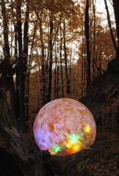 lighted gazing ball mounted in an old log instructions included, gardening, lighting, My original glowing fairyball at dusk