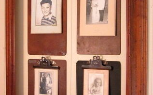a framed clipboard photo wall, home decor, repurposing upcycling, Four old clipboards with black and white vintage photos in vintage folders hang inside a frame