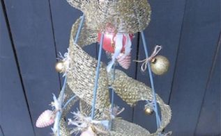 re purposing a tomato cage into a christmas tree, christmas decorations, repurposing upcycling, seasonal holiday decor, Tree decorated This one stands 54 tall but smaller cages are available