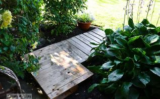 cheating with an instant full pallet garden walkway, concrete masonry, diy, landscape, pallet, repurposing upcycling, The pallets were then tucked into place