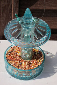diy candy jar birdfeeder, crafts, repurposing upcycling, A view from the top of the bird feeder ready to hang