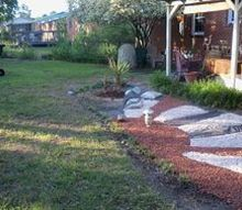 my landscaping adventure, landscape, outdoor living, the yuccas have taken off and blooming as i speak