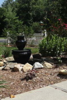 vintage iron cauldron and kettle fountain, flowers, outdoor living, patio, ponds water features, Dug a whole for a tub 32 diameter We used an old flower urn and a bubbler urn to make a fountain This is the result of our yard sale finds