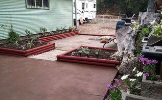 back yard, diy, flowers, gardening, landscape, patio, woodworking projects, I used the dirt that covered the patio to fill in the flower beds and painted the red wood I then painted the 1st patio dark brown