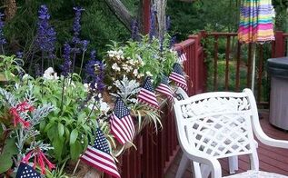 patriotic picnic bbq happy memorial day, outdoor living, patriotic decor ideas, seasonal holiday decor, American flags were added to the deck planters planted with white begonias blue ageratum and red fuchsias