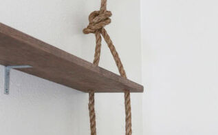 rustic diy wall shelving, diy, how to, shelving ideas, woodworking projects, Using large hook screws to hang the rope Since the rope is only for aesthetics we were able to use these hook screws are not worry about the weight of the shelves The shelves are sturdily in place because of the braces