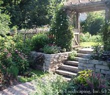 make it a focal point turn obstacles into opportunities and champion challenges, flowers, gardening, landscape, outdoor living, The natural stone step are functional but with the arbor and gate they become a beautiful focal point of this backyard garden paradise Make sure there is enough room at the top and bottom of the steps to linger and enjoy