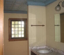 our florida bungalow bathroom redo, bathroom ideas, home decor, woodworking projects, The old bathroom old tin ceiling that had mold and rust and old double vanity that was falling apart and some dizzying wallpaper