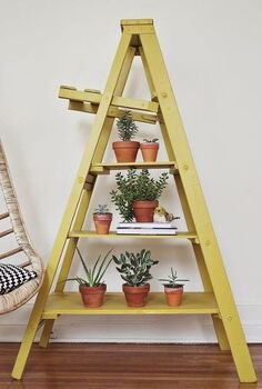 6 new uses for an old ladder, home decor, repurposing upcycling, Display odds and ends Need a place to display your stuff Give your ladder a fresh coat of paint and create tiered shelves by adding a few planks of wood across each set of steps