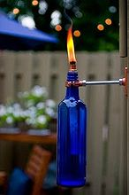 ideas on how to recycle wine bottles, outdoor living, repurposing upcycling, Recycled wine bottle torches