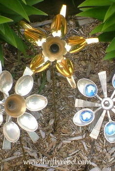 how to make cutlery flowers using spoons, crafts, flowers, gardening, repurposing upcycling, My cutlery flowers planted in the garden