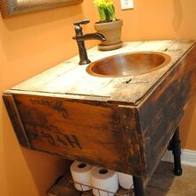 bathroom vanity from a wall cabinet, diy renovations projects, repurposing upcycling, We attached it to the wall with the plumbing flanges and hooked up our plumbing lines I added some barnwood pieces to act as a storage shelf resting on top of the pipe