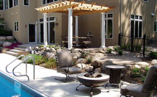 custom arbors amp pergolas by switzer s, outdoor living, Pergolas can be used to create human scale The space is made more comfortable by adding a visual ceiling to the back of the large house An outdoor dining area is much more cozy with the room feeling created by the pergola