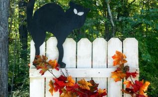diy black cat decoration for halloween, crafts, halloween decorations, seasonal holiday decor, We even added our cat to the cute pumpkin fence we made