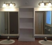 large bathroom mirror redo to double framed mirrors and cabinet, bathroom ideas, home decor, shelving ideas, bottom of cabinet dressed then realized I needed more height to cover the original light hole grrr