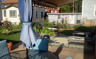 my large landscape project, flowers, gardening, landscape, I had no place to set in an shade in my backyard so I had a Sunsetter retractable awning installed with patio lights