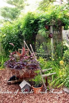 a trip down memory lane my former garden, flowers, gardening, outdoor living, patio, rusty wheelbarrow planting by the arbor swing