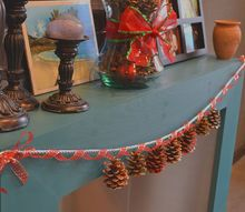 simple scented dazzling pine cone garland, crafts, seasonal holiday decor, I used a thick silver rope ribbon to hold the weight of the pine cones and then strung a gold and red ribbon around it to dress it up and add more depth