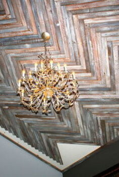 reclaimed wood herringbone pattern on the ceiling, diy, how to, woodworking projects, Couldn t wait to see the new chandy in place The small cuts will take forever I m sure