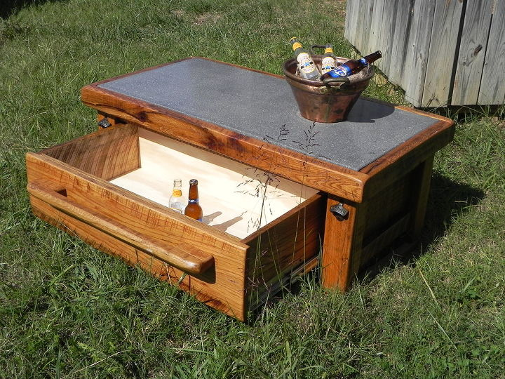 The ultimate outdoor cocktail cooler table hometalk for Outdoor coffee table with cooler