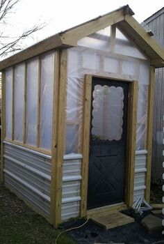greenhouse built for less than 700, diy, gardening, outdoor living, The size is 8 x 10 and 8 high With the angle of the roofline we re going to add a hanging rod this year before fall sets in Old storm door we had in storage for front door