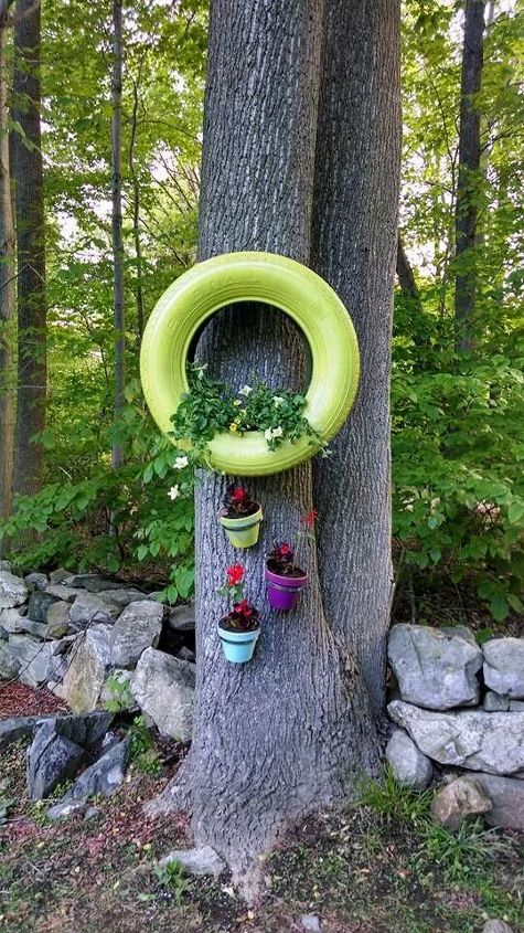 Repurposed tires spray painted and turned into planters - Painted tires for gardens ...