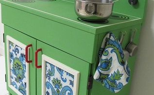 before amp after the makeover of a wooden play kitchen, chalk paint, diy, how to, painted furniture, I lined the doors with vintage fabric from a thrift store table cloth and used cup hooks to hold thrift store measuring spoons